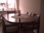 Dark wood dining room table and chairs