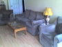 Mushroom coloured four seater sofa and two armchairs