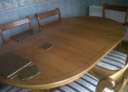 extendeble dininng table and six two carvers chairs