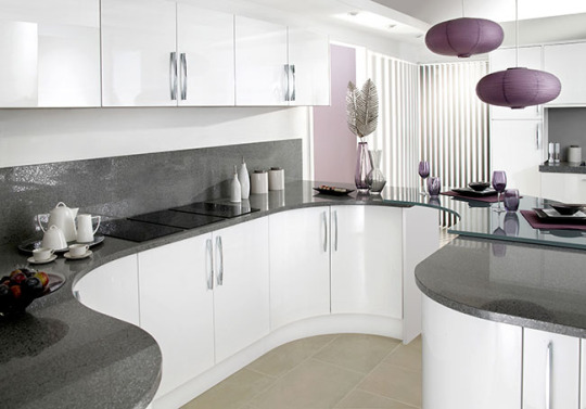If you want unique look of your kithen then we at regency kitchen provide best designs of cupboard and large breakfast bar seperating the  kitchen and dinning room. contact us for other query!