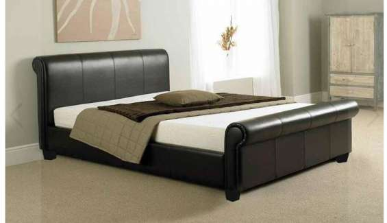 Upgrade your bedroom with our como modern faux leather sleigh bed